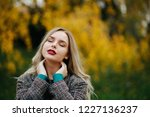 attractive model with closed... | Shutterstock . vector #1227136237