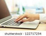 female hand writing on  laptot  ... | Shutterstock . vector #122717254