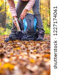 hiker is taking thermos out... | Shutterstock . vector #1227174061