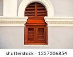 window with wooden shutters on... | Shutterstock . vector #1227206854