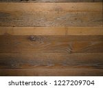 dark stained brown reclaimed... | Shutterstock . vector #1227209704