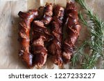 top view of grilled sausages.  | Shutterstock . vector #1227233227