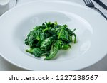 garnish steamed spinach   Shutterstock . vector #1227238567