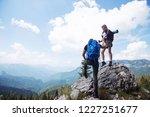 active couple of hikers outdoor | Shutterstock . vector #1227251677