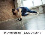 asian women exercise indoor at... | Shutterstock . vector #1227291547