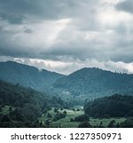 mountain valley with green... | Shutterstock . vector #1227350971