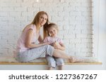 beautiful blonde mother and...   Shutterstock . vector #1227367267