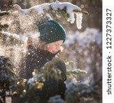 closeup of a kid boy who pulls... | Shutterstock . vector #1227373327