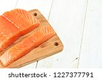 red fish on a wooden white table | Shutterstock . vector #1227377791
