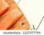 red fish on a wooden white table | Shutterstock . vector #1227377794