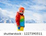 child in alpine ski school with ... | Shutterstock . vector #1227390511