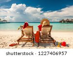 couple on a tropical beach in... | Shutterstock . vector #1227406957
