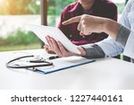 doctor consulting with patient... | Shutterstock . vector #1227440161