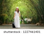 time to relax  happy traveler... | Shutterstock . vector #1227461401