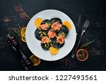 black ravioli with salmon and... | Shutterstock . vector #1227493561