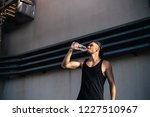 young sporty man drinking water ... | Shutterstock . vector #1227510967
