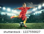 young boy with soccer ball... | Shutterstock . vector #1227550027
