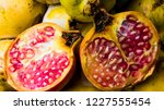 pomegranate fruit on a wooden... | Shutterstock . vector #1227555454