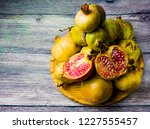 pomegranate fruit on a wooden... | Shutterstock . vector #1227555457