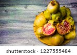 pomegranate fruit on a wooden... | Shutterstock . vector #1227555484