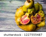 pomegranate fruit on a wooden... | Shutterstock . vector #1227555487