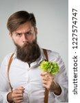 a man with a beard eating a... | Shutterstock . vector #1227574747