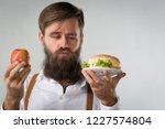 man with a beard chooses... | Shutterstock . vector #1227574804