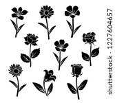 set of silhouettes of flowers... | Shutterstock .eps vector #1227604657