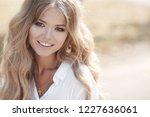 beautiful young woman autumn... | Shutterstock . vector #1227636061
