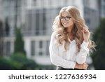 woman portrait in city street.... | Shutterstock . vector #1227636934