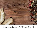 mix of peppercorns on rustic... | Shutterstock . vector #1227675541