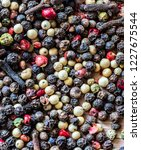 mix of peppercorns on rustic... | Shutterstock . vector #1227675544