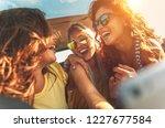 three female friends enjoying... | Shutterstock . vector #1227677584