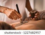 closeup of beautician applying... | Shutterstock . vector #1227682957