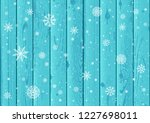 christmas snowfall on blue wood ... | Shutterstock .eps vector #1227698011