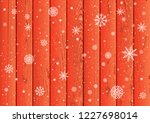 christmas snowfall on red wood... | Shutterstock .eps vector #1227698014