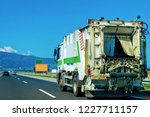 truck carrying trailer with... | Shutterstock . vector #1227711157
