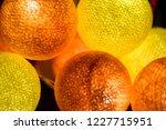 yellow orange glowing balls... | Shutterstock . vector #1227715951