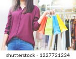 consumerism woman holding many... | Shutterstock . vector #1227721234