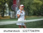 attractive athlete with a... | Shutterstock . vector #1227736594