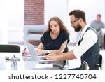 business colleagues using a... | Shutterstock . vector #1227740704