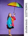 kid girl happy hold colorful... | Shutterstock . vector #1227763441
