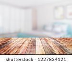 closeup top wood table with...   Shutterstock . vector #1227834121