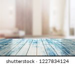 closeup top wood table with...   Shutterstock . vector #1227834124