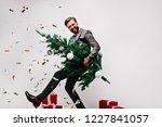blissful dark haired man... | Shutterstock . vector #1227841057