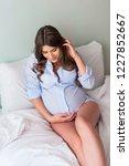 beautiful young pregnanat woman ... | Shutterstock . vector #1227852667