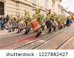 Small photo of Steinenberg, Basel, Switzerland - February 19th, 2018. A group of carnival participants in colorful costumes playing snare drums