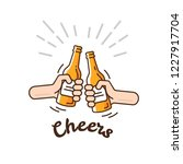 two hands clink bottles with... | Shutterstock .eps vector #1227917704