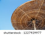 beach straw umbrella against... | Shutterstock . vector #1227929977