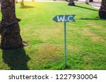 wc sign indication on the beach.... | Shutterstock . vector #1227930004